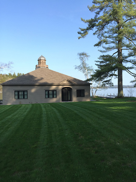 Organic landscaping is the best choice for this Sunapee lakeside home